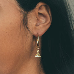 bryan anthonys earring charm collection mini base hoop with tribe friendship earring charm on model close-up