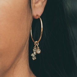 maxi hoop earring base 14k gold with beautifully broken earring charm and one day at a time earring charm close-up on model