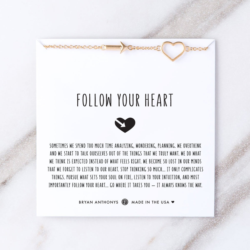 follow your heart gold necklace on card