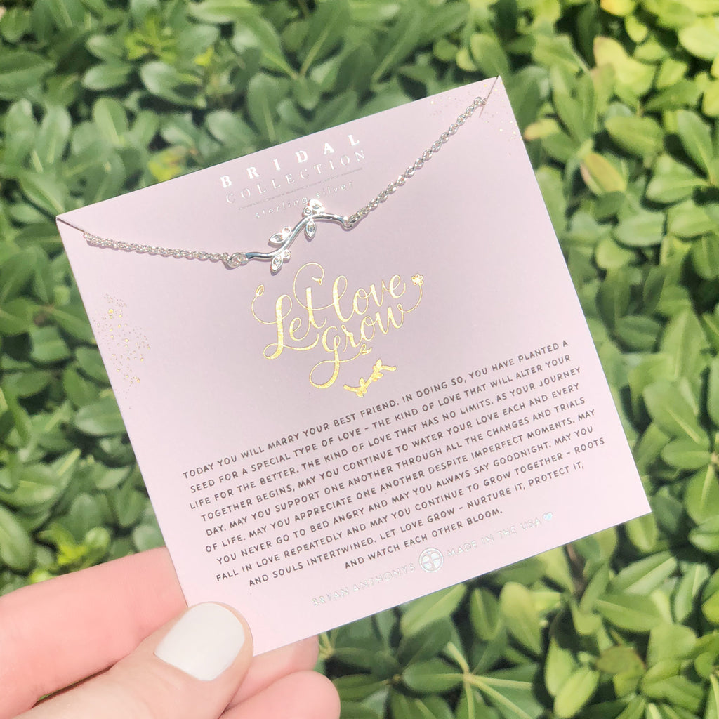 Bryan Anthonys dainty let love grow bridal necklace sterling silver held