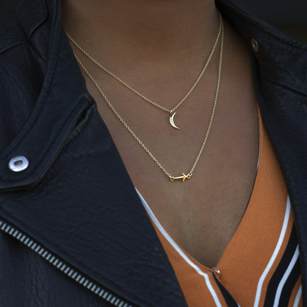 moon and back necklaces layered close-up modeled in 14k gold