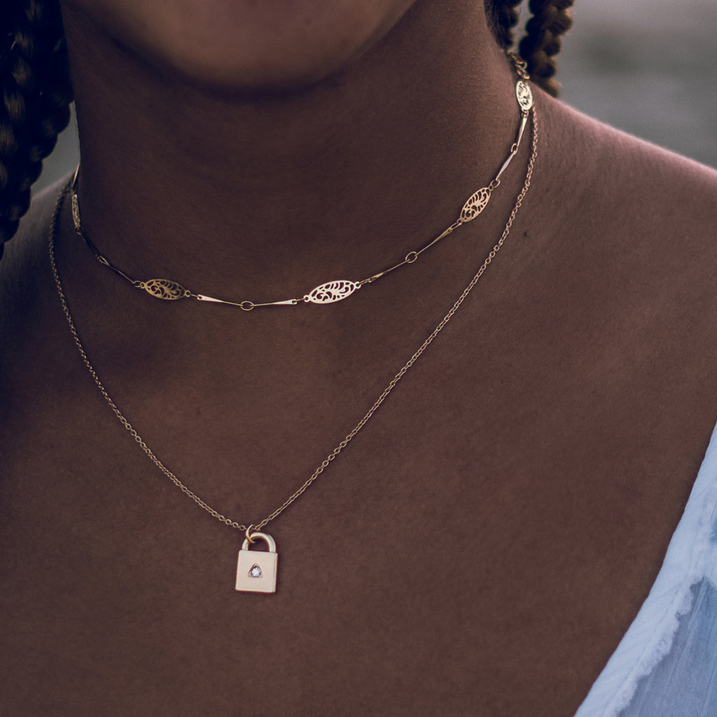 layered necklaces close-up on model bryan anthonys open spaces dainty choker