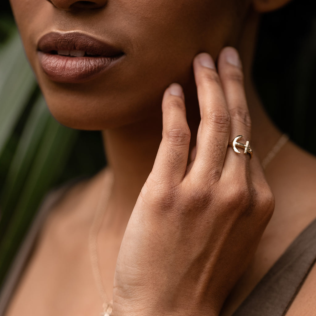 close up stay grounded anchor ring 14k gold on model