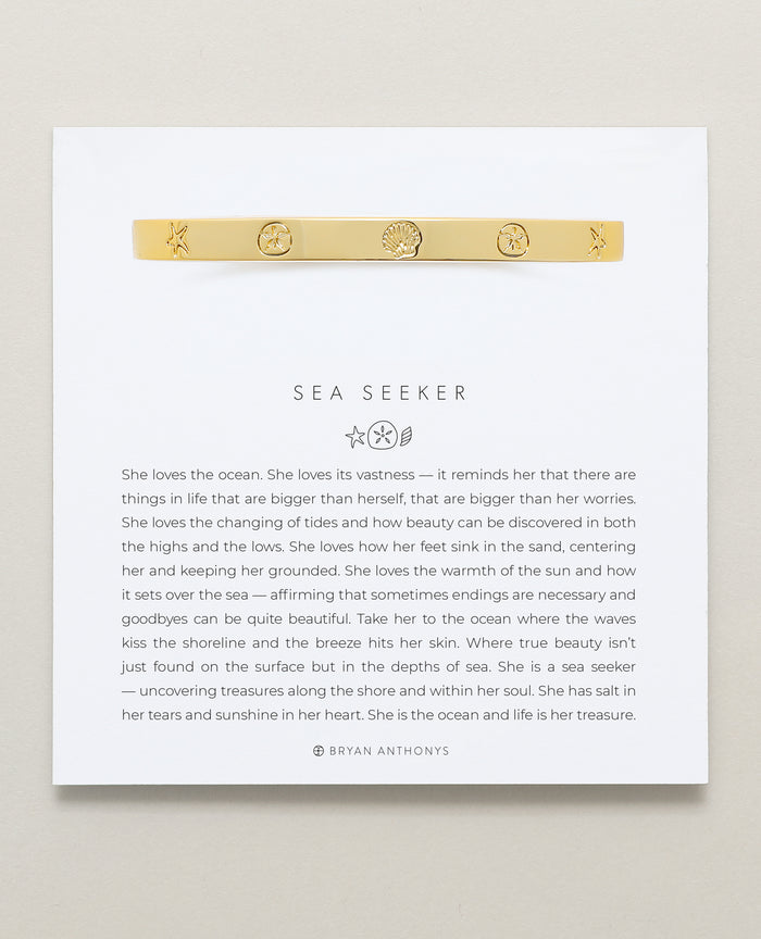 Bryan Anthonys Sea Seeker Gold Hinged Bracelet with sea shell engravings on card