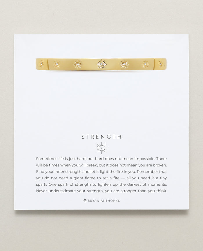 Bryan Anthonys Strength Gold Hinged Bracelet with Crystals on card