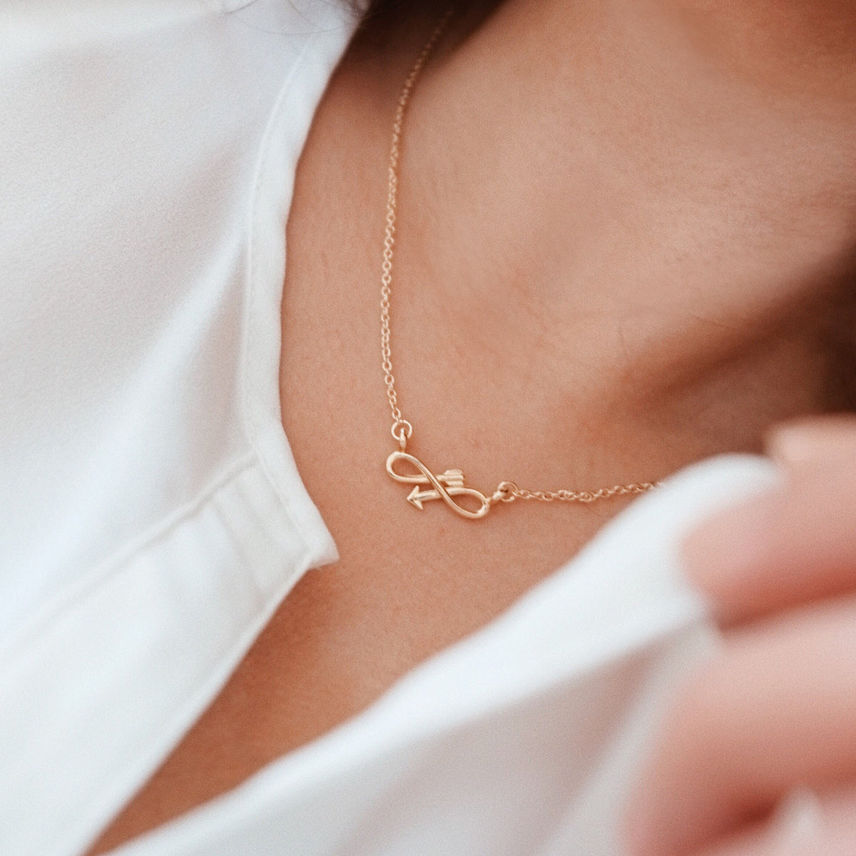 7b65621ff Bryan Anthonys dainty infinity endless arrow necklace 14k gold modeled  close-up