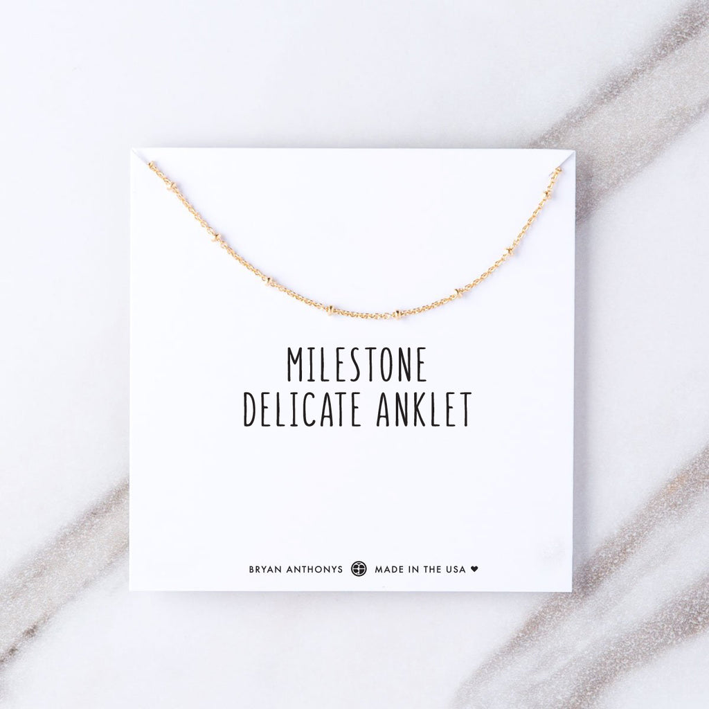 milestone delicate anklet on jewelry card