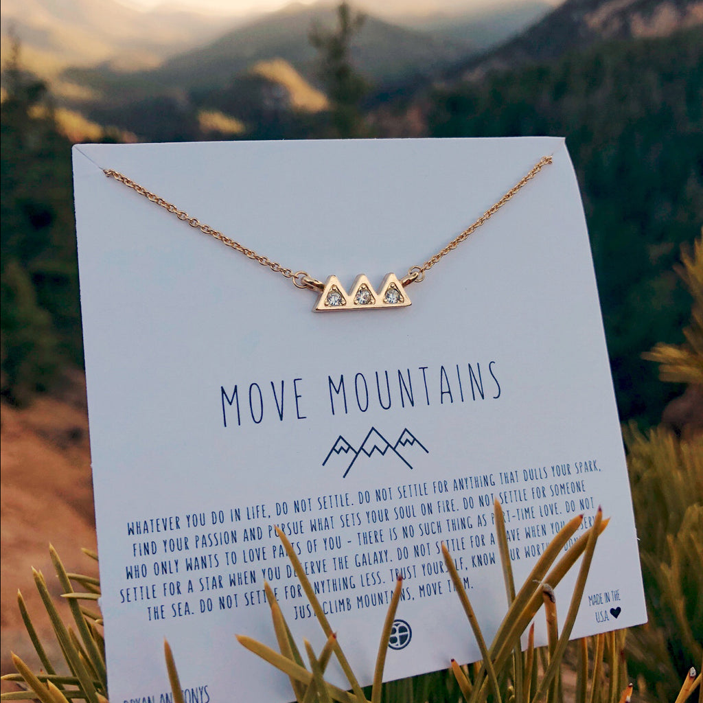 Bryan Anthonys dainty move mountains necklace on card