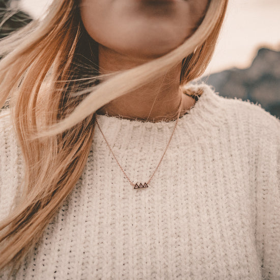 Bryan Anthonys dainty move mountains necklace rose gold modeled close-up