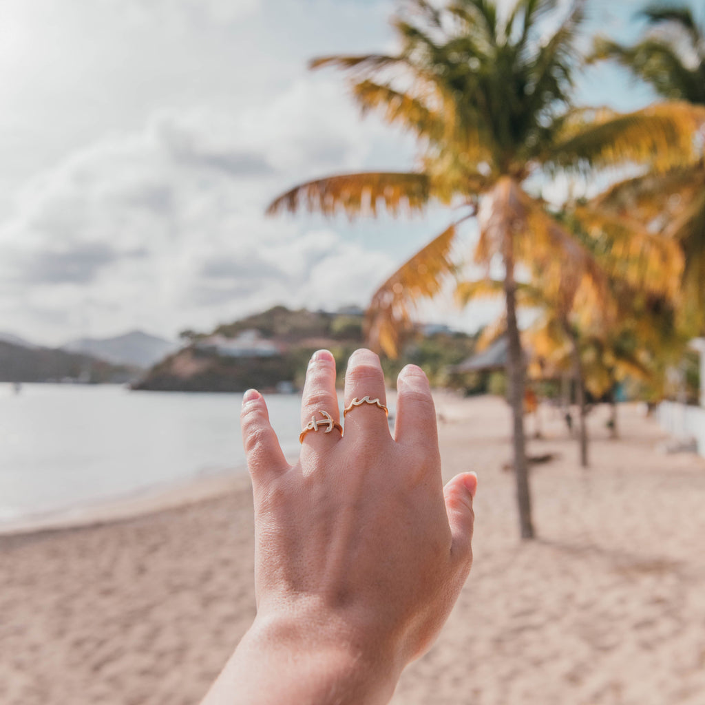 stay grounded ring 14k gold modeled on beach lifestyle beach collection