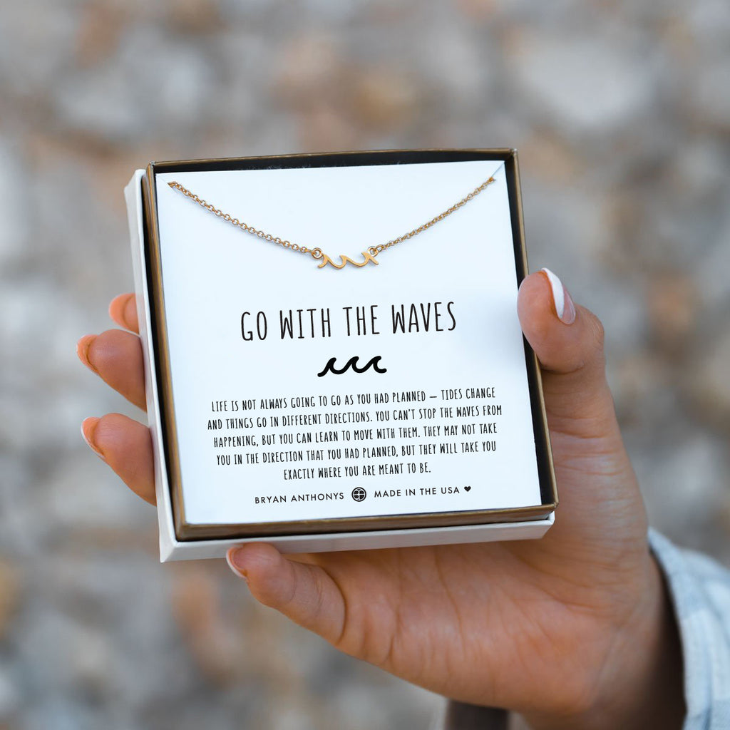 go with the waves gold bracelet on jewelry card