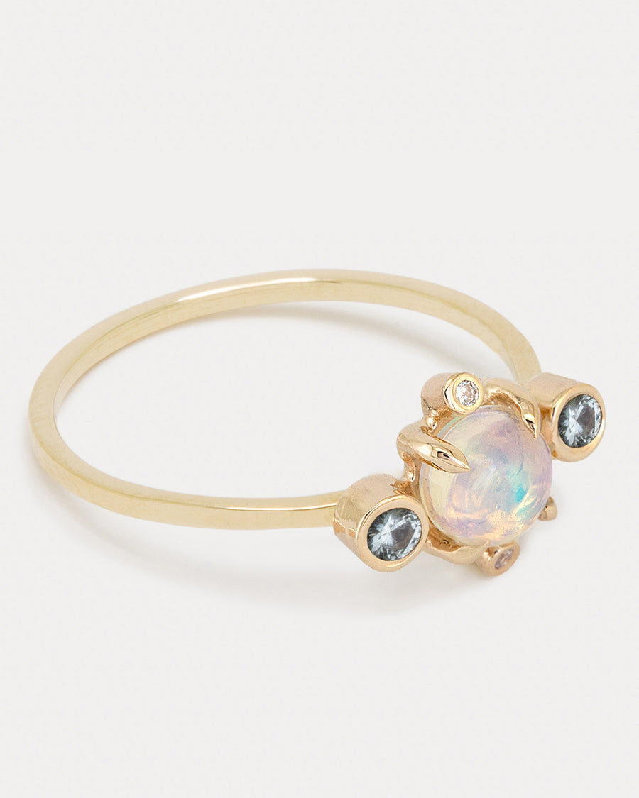 <b>Astral Ring</b><br>Opal & Blue Topaz <br> Gold