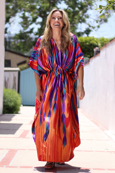 Bright colored caftan dress in orange and fuchsia by Winlar
