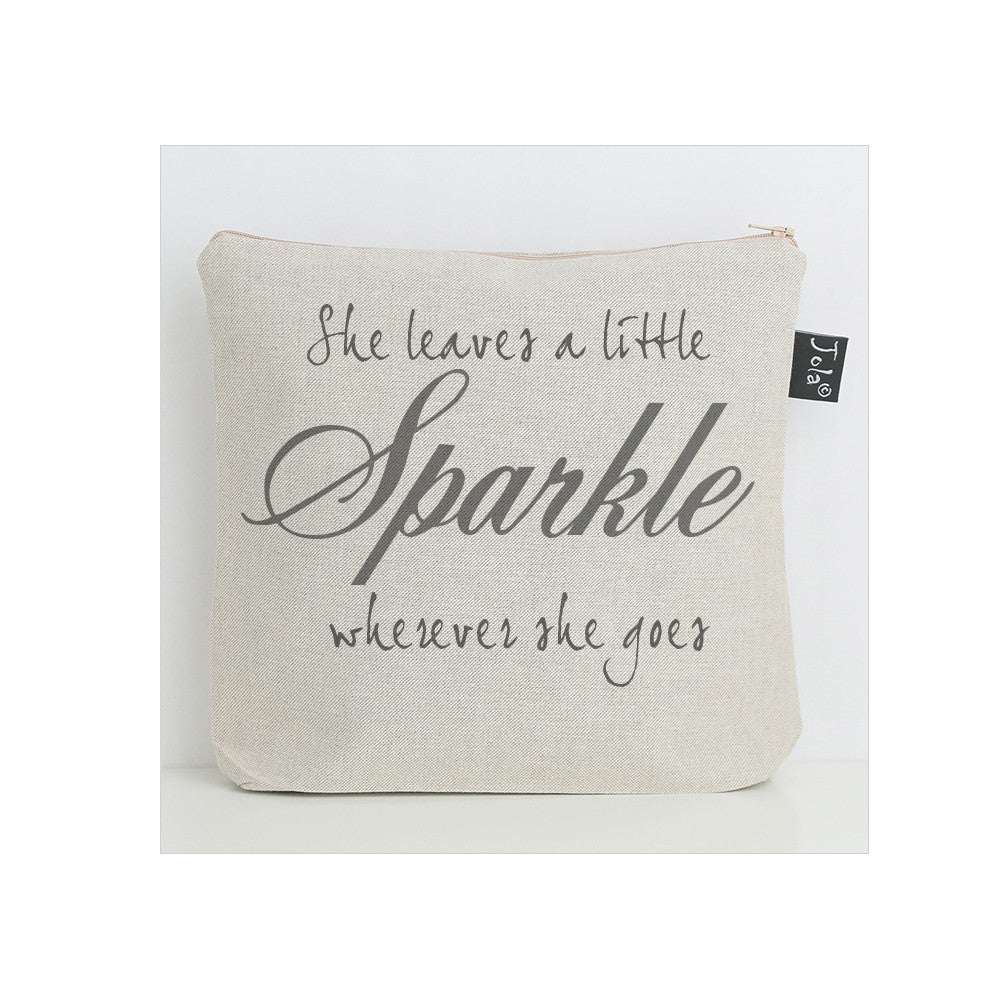 She leaves sparkle wash bag