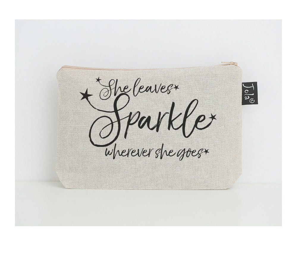 She leaves sparkle stars black small make up bag