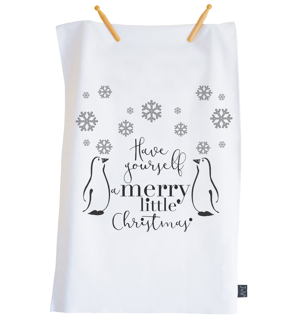 Penguin snowflakes Christmas tea towel