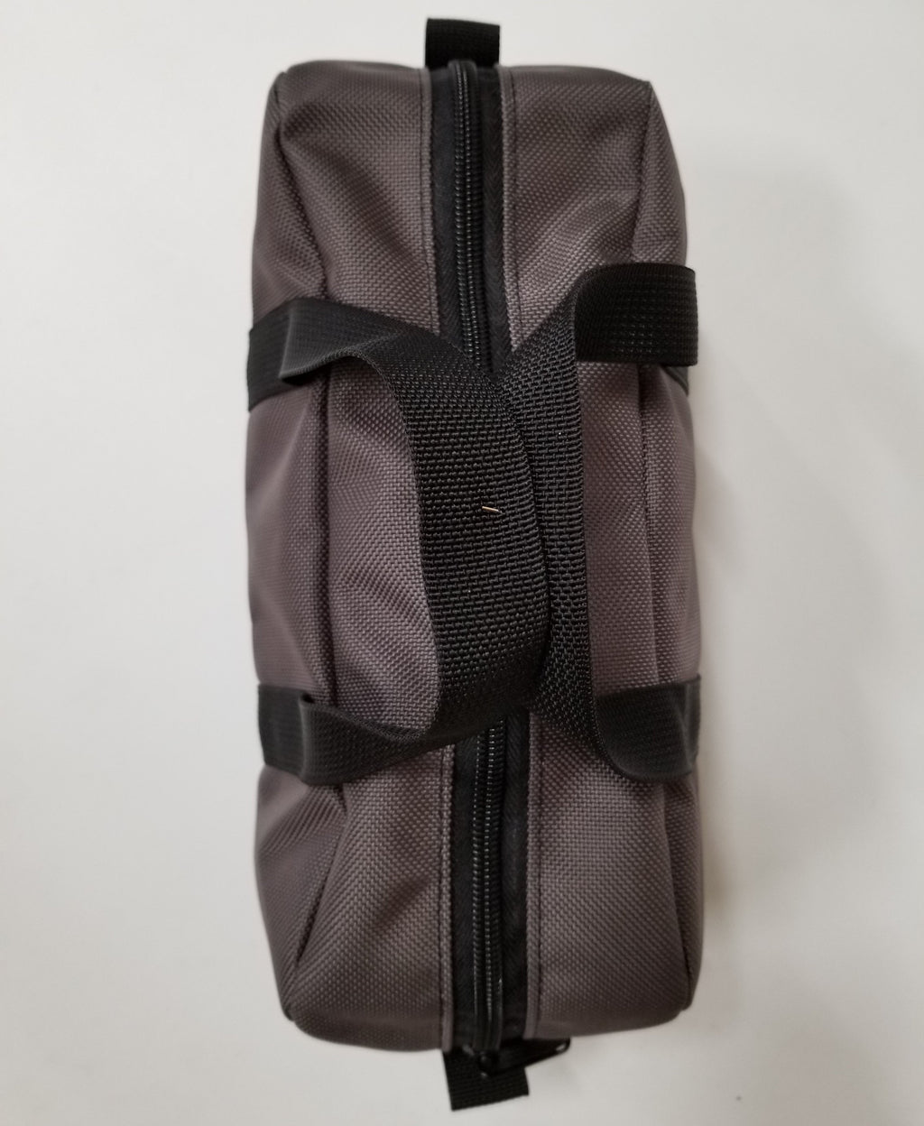 Grey Mini Duffle with Black Webbing Straps Top View