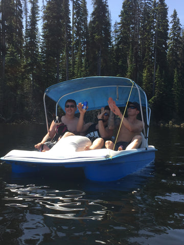 boys on the pedal boat