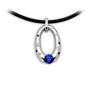 Small Oval Pendant with Scattered Melee and Tension-Set Blue Sapphire