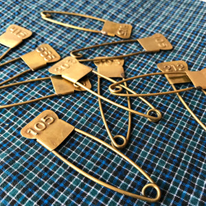 Vintage style brass number pins handmade in India for Fog Linen available at Tribe Castlemaine