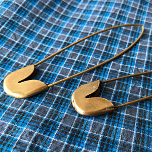 Traditional large-scale brass safety pins handmade in India for Fog Linen available at Tribe Castlemaine