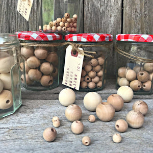 Natural, unfinished wooden beads for craft at Tribe Castlemaine