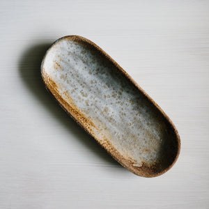 Stoneware canoe platter in salted cocoa handmade by Woodfolk Natural Accessories