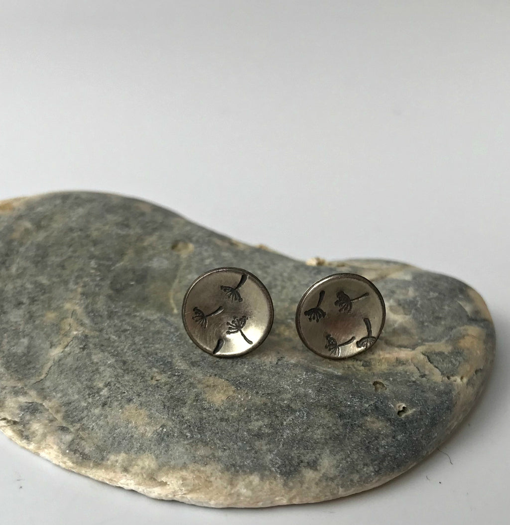 Domed silver stud earrings with stamped botanical detail