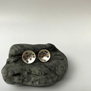 Domed silver stud earrings with stamped freckle dot detail