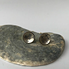Silver domed stud earrings with stamped kisses detail