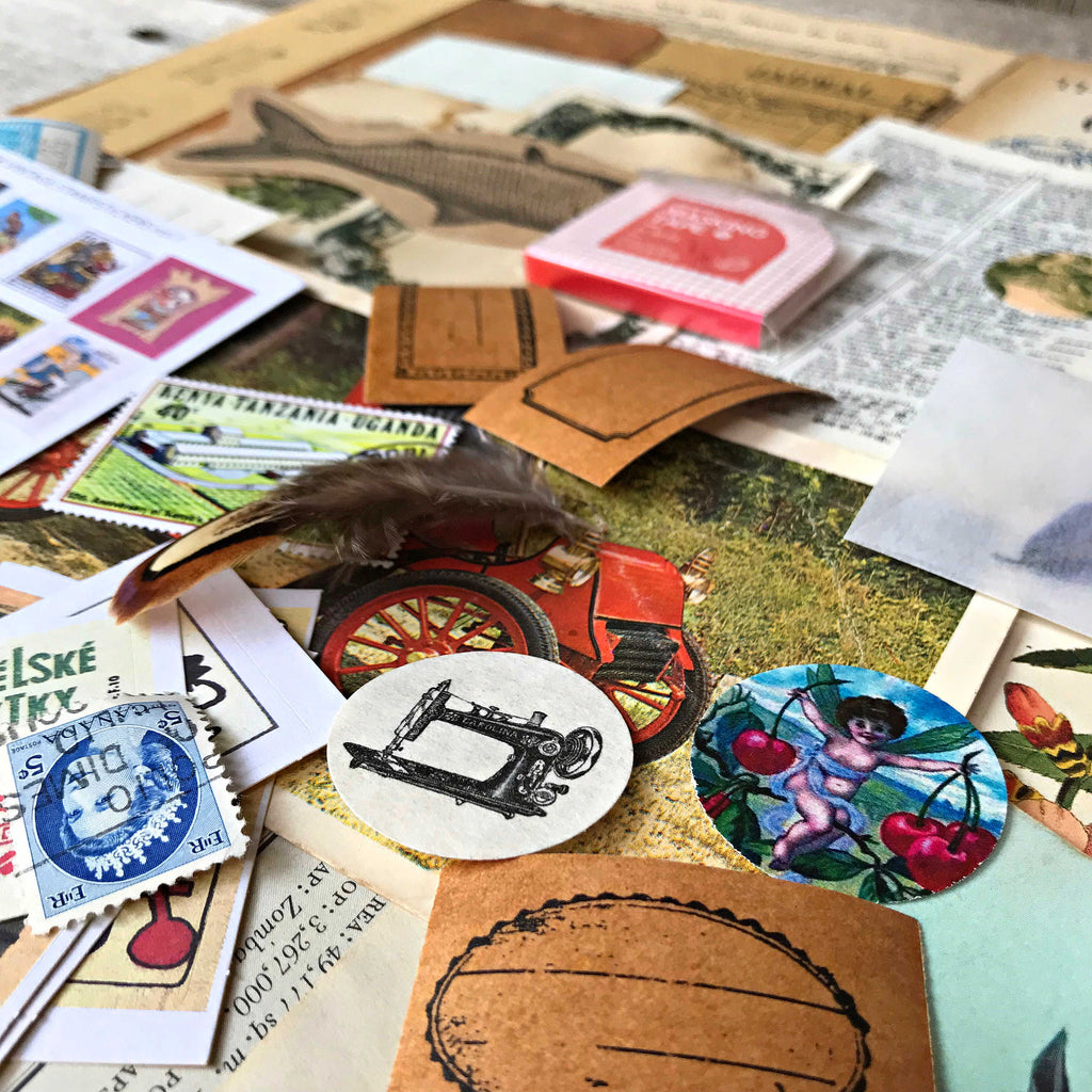 Ephemera pack brimming with vintage style papercraft items