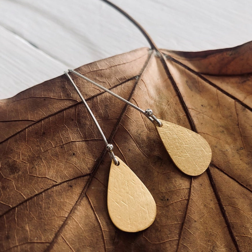 Flocked gold tear earrings handmade by Paird