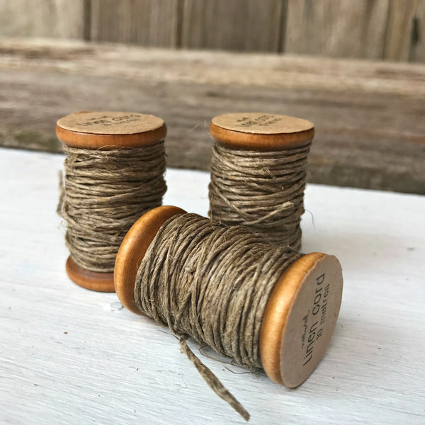 Natural quality linen cord presented on a vintage-style wooden bobbin, a lovely crafting addition from Tribe Castlemaine