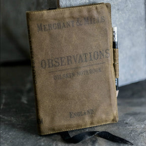 Handmade A6 notebook cover in quality antique British oilskin from Merchant & Mills at Tribe Castlemaine.