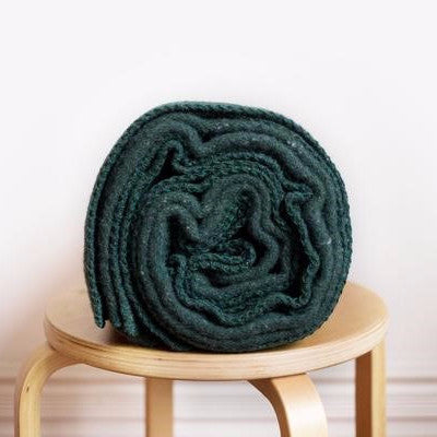 Luxurious, durable recycled wool blanket, in pine green, made at Australia's oldest woollen mill by Seljak Brand at Tribe Castlemaine.