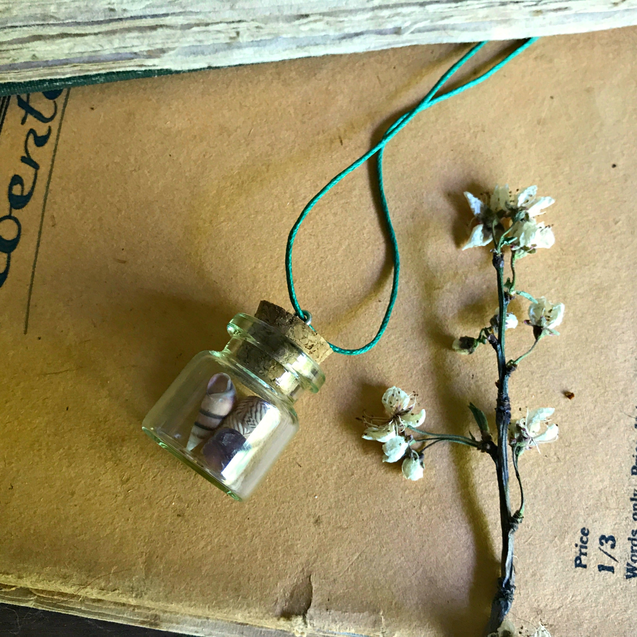 Sweet little treasure necklace with tiny glass bottle handmade at Tribe Castlemaine