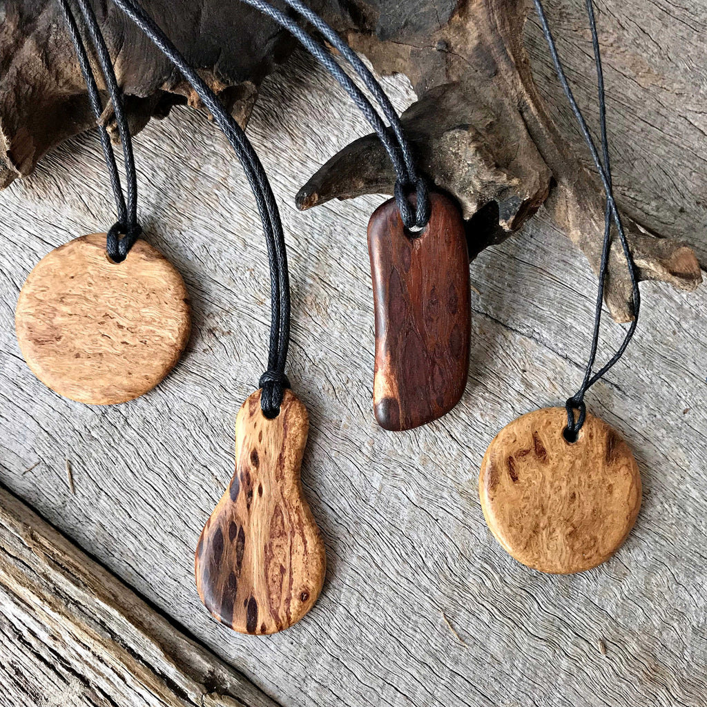 Handmade wooden necklaces made from reclaimed doolalia timber