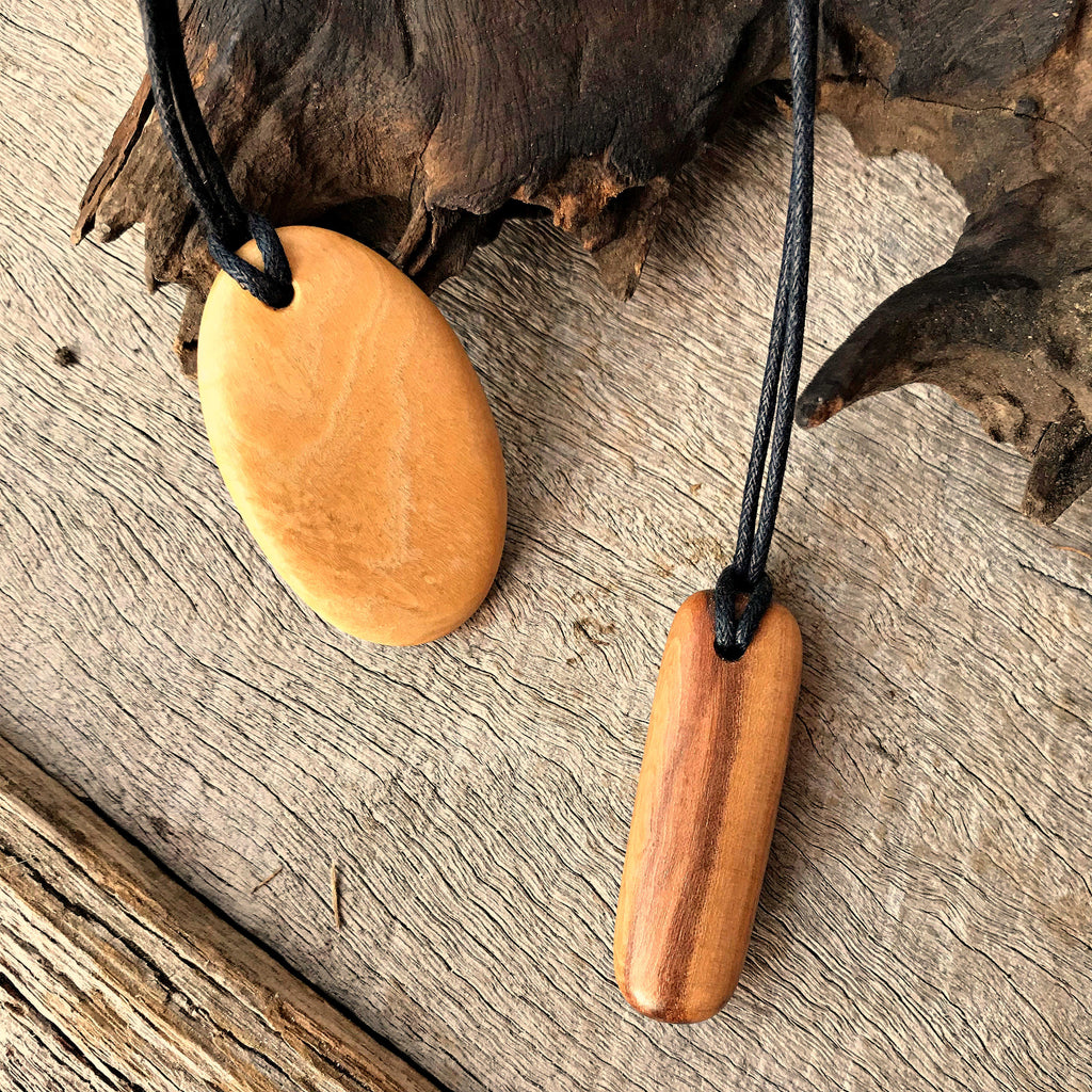 Wooden pendant necklaces handmade from reclaimed leopardwood