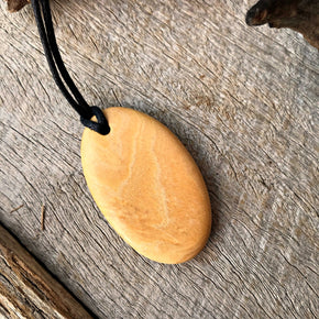Handmade wooden pendant necklaces made from reclaimed leopardwood