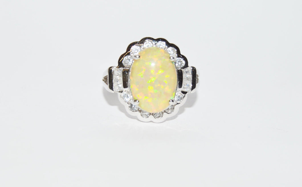 Opal And CZ .925 Sterling Silver Ring www.hersandhistreasures.com/collections/sterling-silver-jewelry