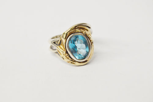 14k Yellow Gold And .925 Sterling Silver Blue Topaz Ring www.hersandhistreasures.com/collections/sterling-silver-jewelry