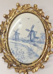 1976 Oval Porcelain Windmill Pictures Set In A Gold Toned Pendant Brooch Pin