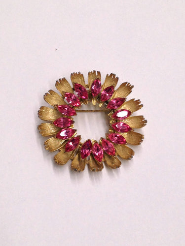 www.hersandhistreasures.com/products/Gold-Toned-Round-Brooch-With-Pink-Rhinestones