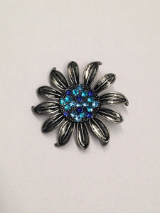 www.hersandhistreasures.com/products/Flower-Brooch-With-Blue-Rhinestone-Center