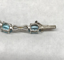 Load image into Gallery viewer, Blue Topaz Sterling Silver Infinity Bracelet