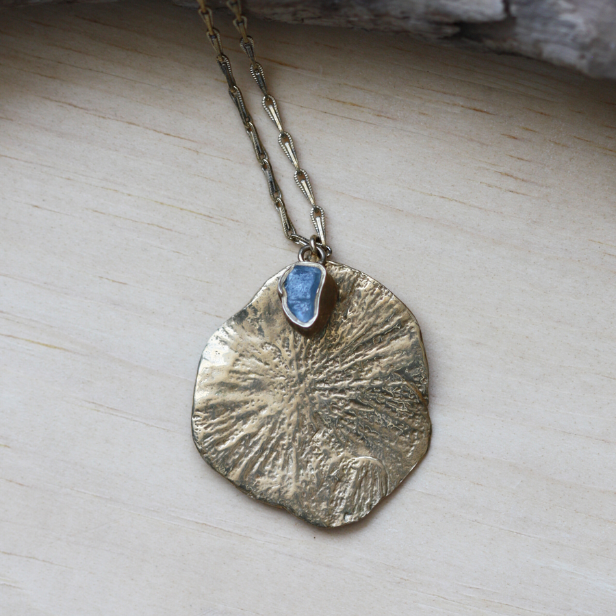 Sand Dollar Pendant Necklace With An Aquamarine In Brass