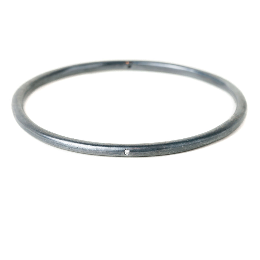 Modeled Bangle with White Diamonds in Oxidized Silver