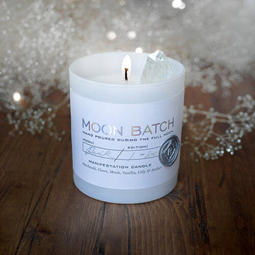 Starlight Blend Soy Candle: Notes of patchouli, clove musk, lily, and amber.