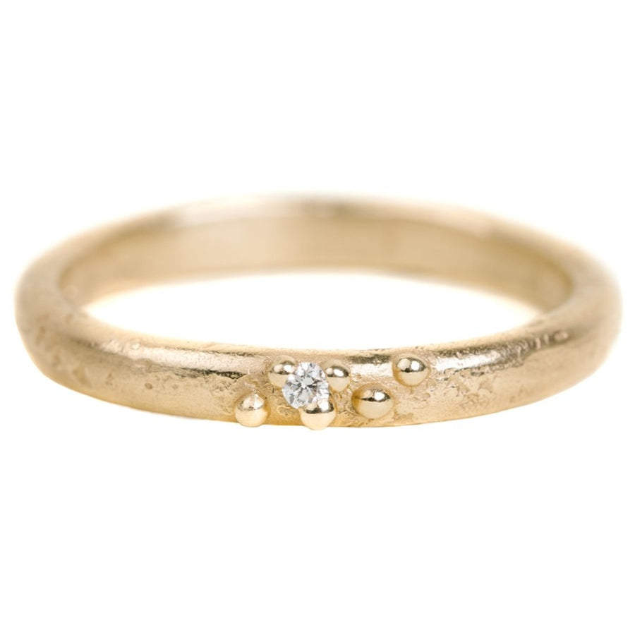 Textured Half Round Wedding Band In Yellow Gold With A Diamond