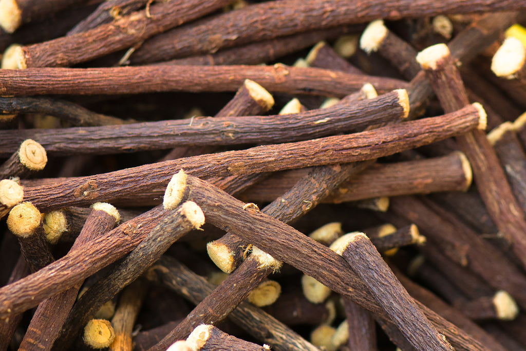 A group of brown stems in a pile